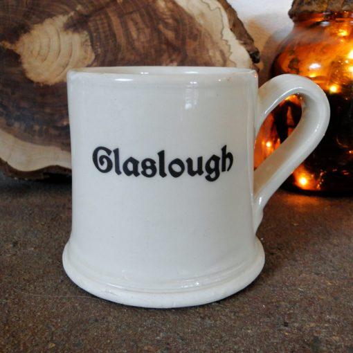 Cream coloured mug with text reading Glaslough